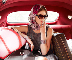 girl-in-the-car-with-bags_thumb